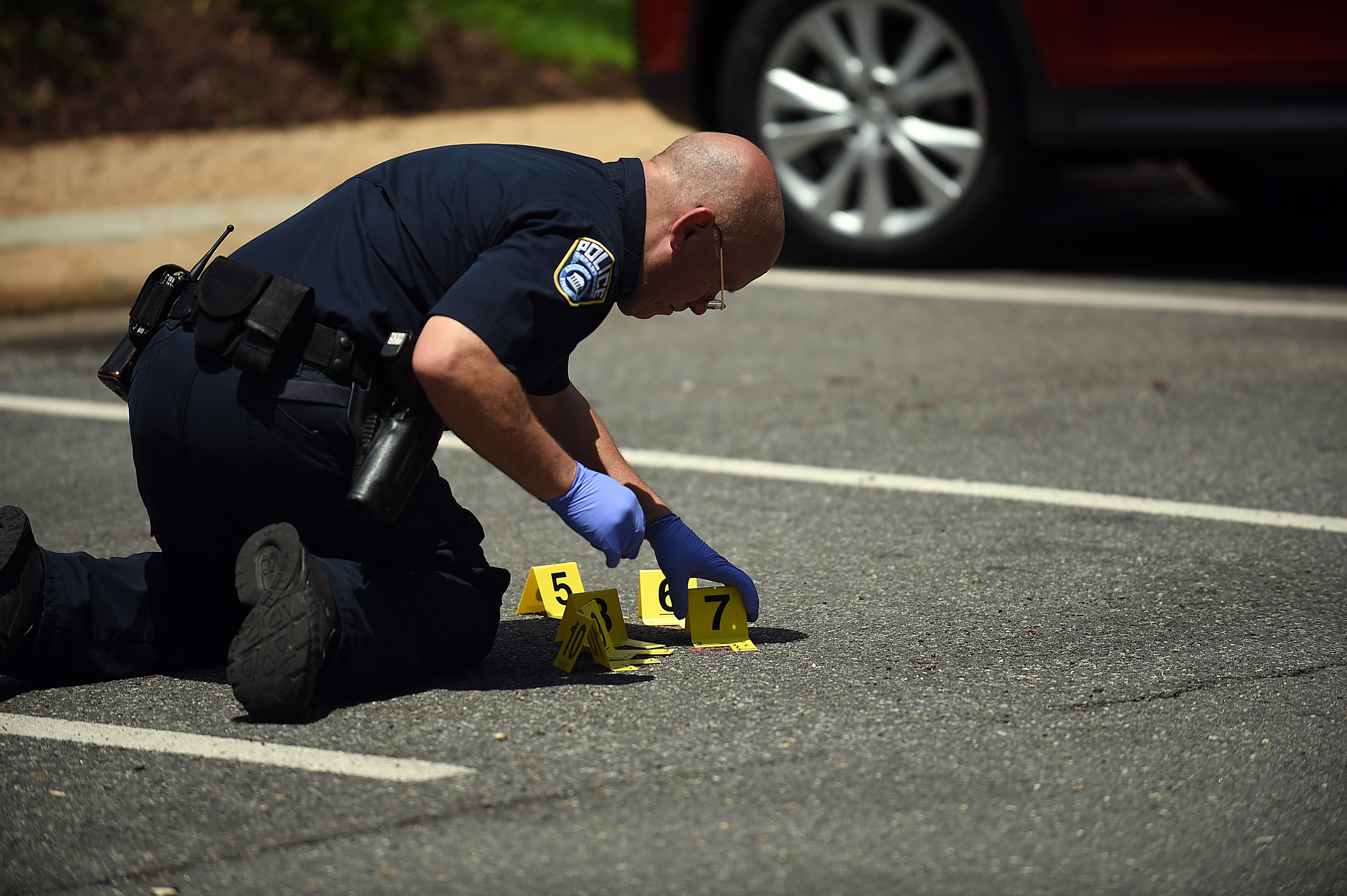 ARLINGTON, VA - May 18: Crime scene marker are placed near an a