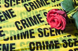 Crime scene tape and a red rose