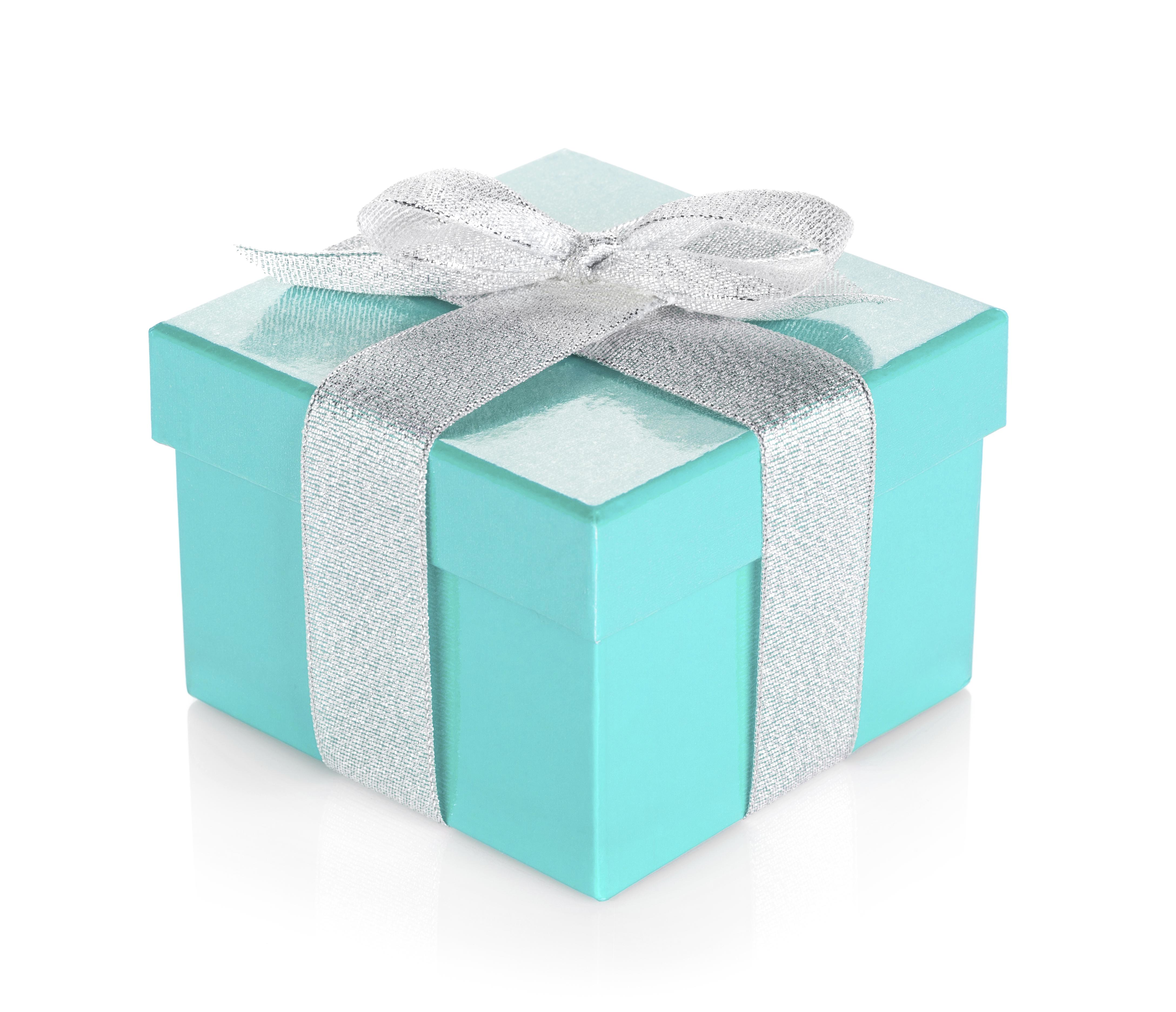 Blue gift box with silver ribbon and bow. Isolated on white background