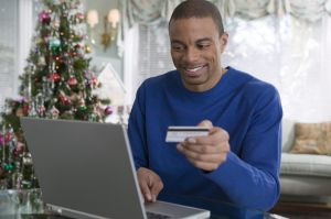 Man with credit card and laptop computer