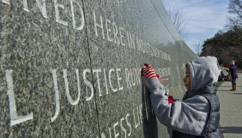 Folks gather at the Martin Luther King, Jr. memorial, open for the first time on MLK Day