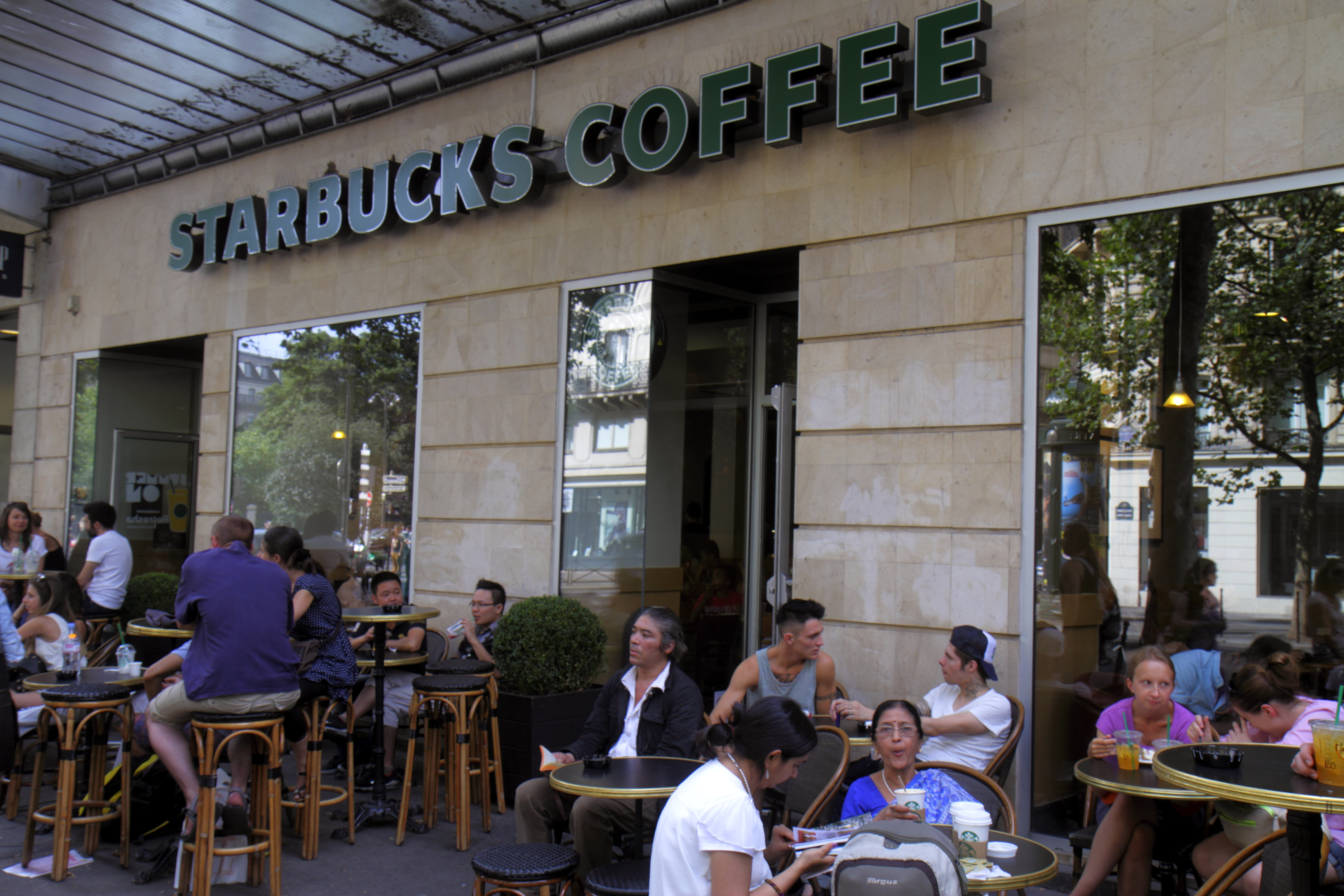 Paris, Boulevard de SŽbastopol Starbucks Coffee tables chairs customers alfresco