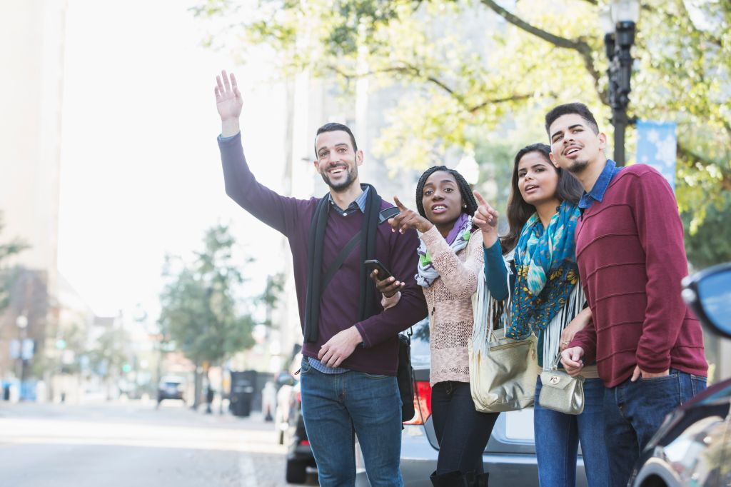 Multi-ethnic group of young adults waiting for ride