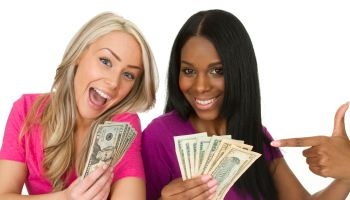 two women with money