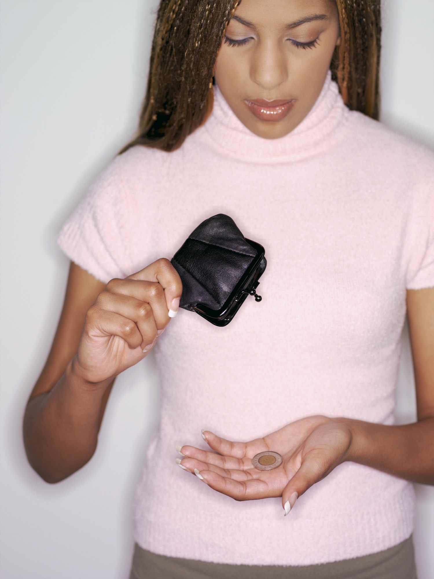 Woman holding coin purse and canadian coin