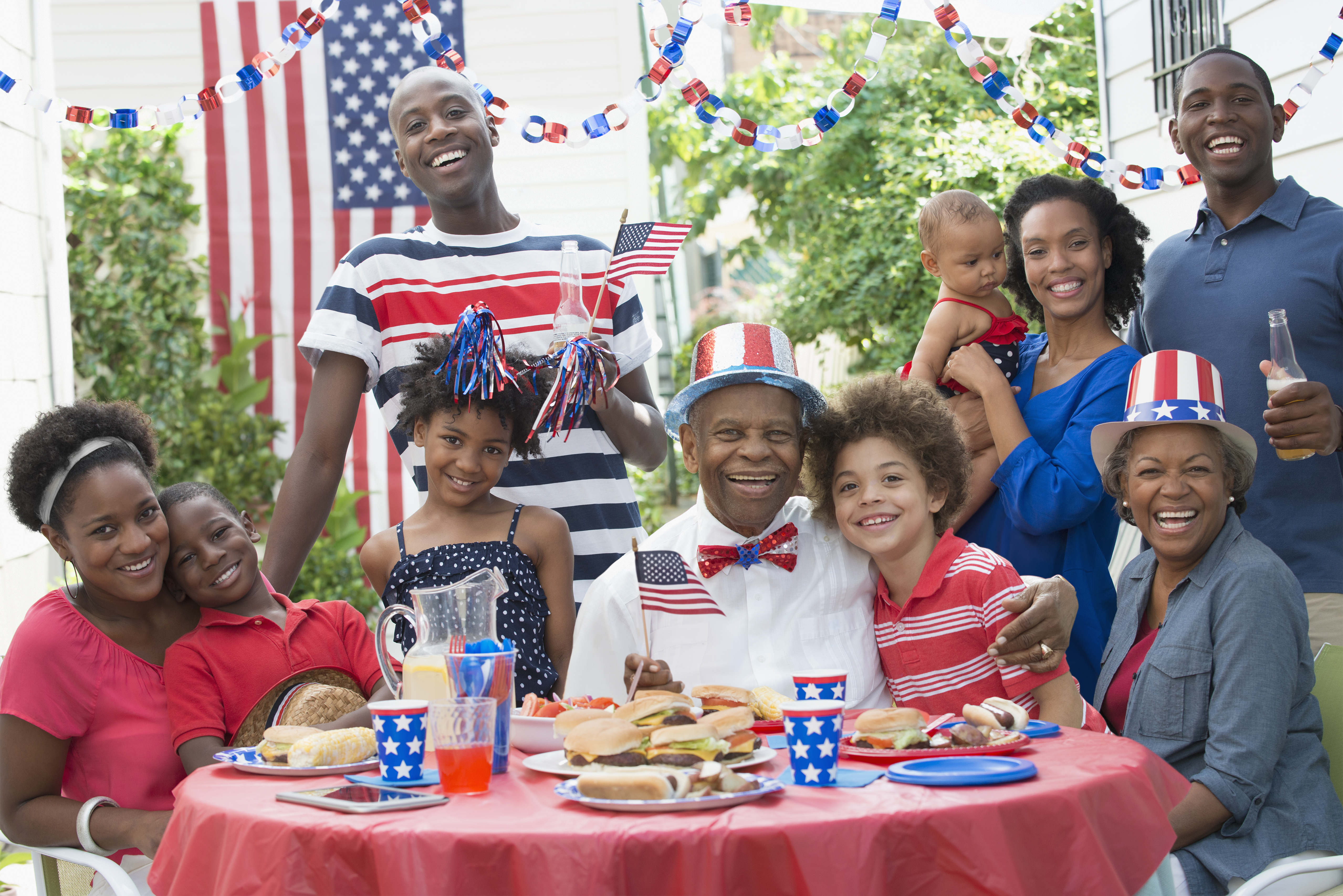 Multi-generation family smiling at Fourth of July barbecue