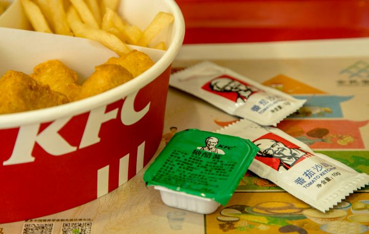 KFC food box filled with fried chicken and chips. Since...