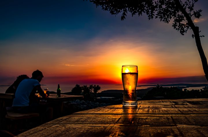 Scenic sunset with beer
