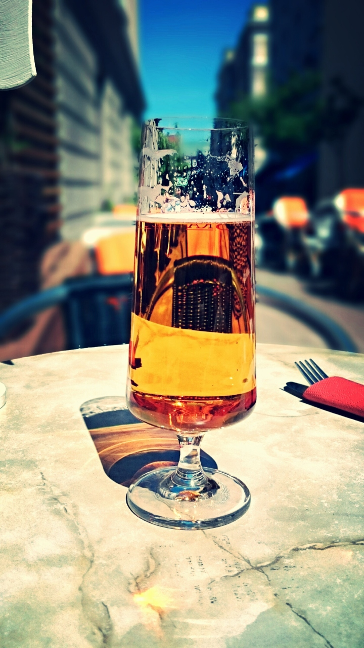 Close-Up Of Beer In Drinking Glass On Table In Sunny Day