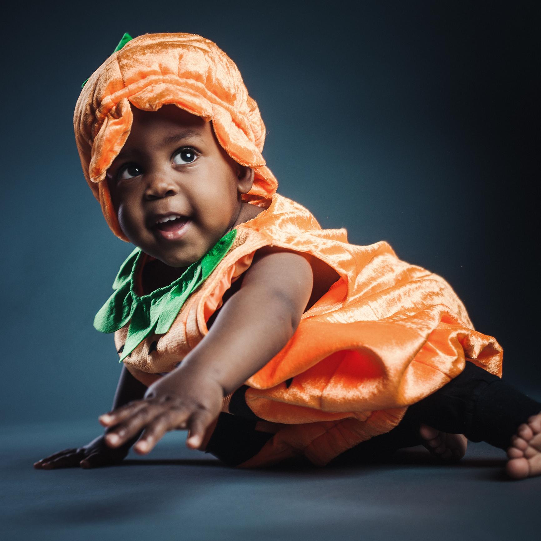 Cute baby boy in pumpkin costume