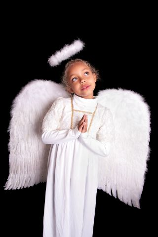 Small girl just as Angel with hands praying
