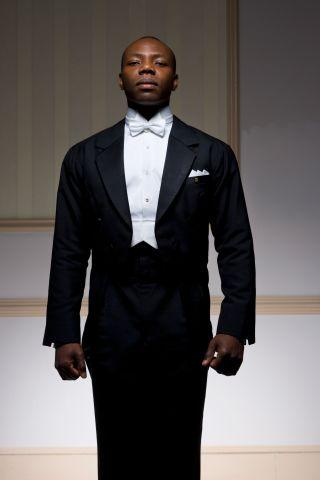 Male ballroom dancer standing, portrait