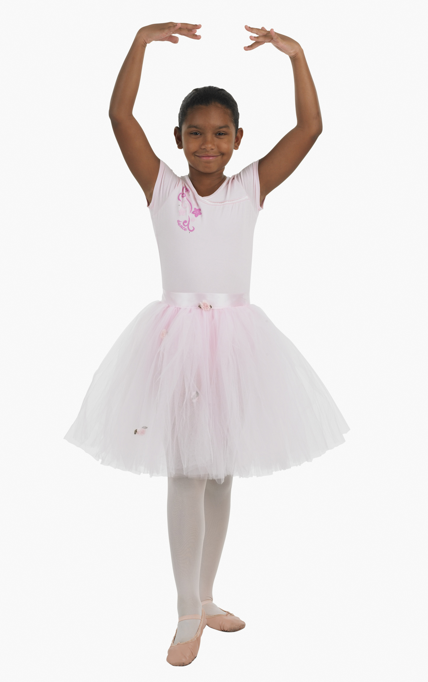 Studio shot of girl practicing ballet