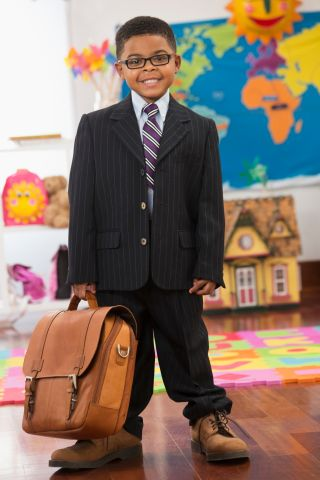 Black boy wearing businessman costume