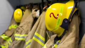 Coats and helmets of fire fighters hanging on hooks