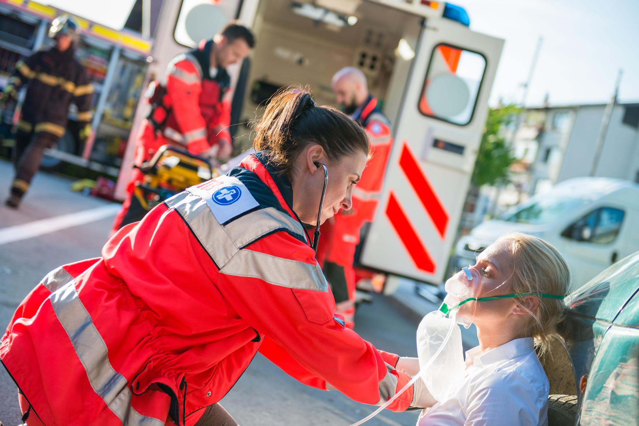 Female Paramedic Helping Injured Women