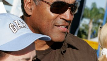 OJ Simpson posing for a photo with a woman at the Arts Festival