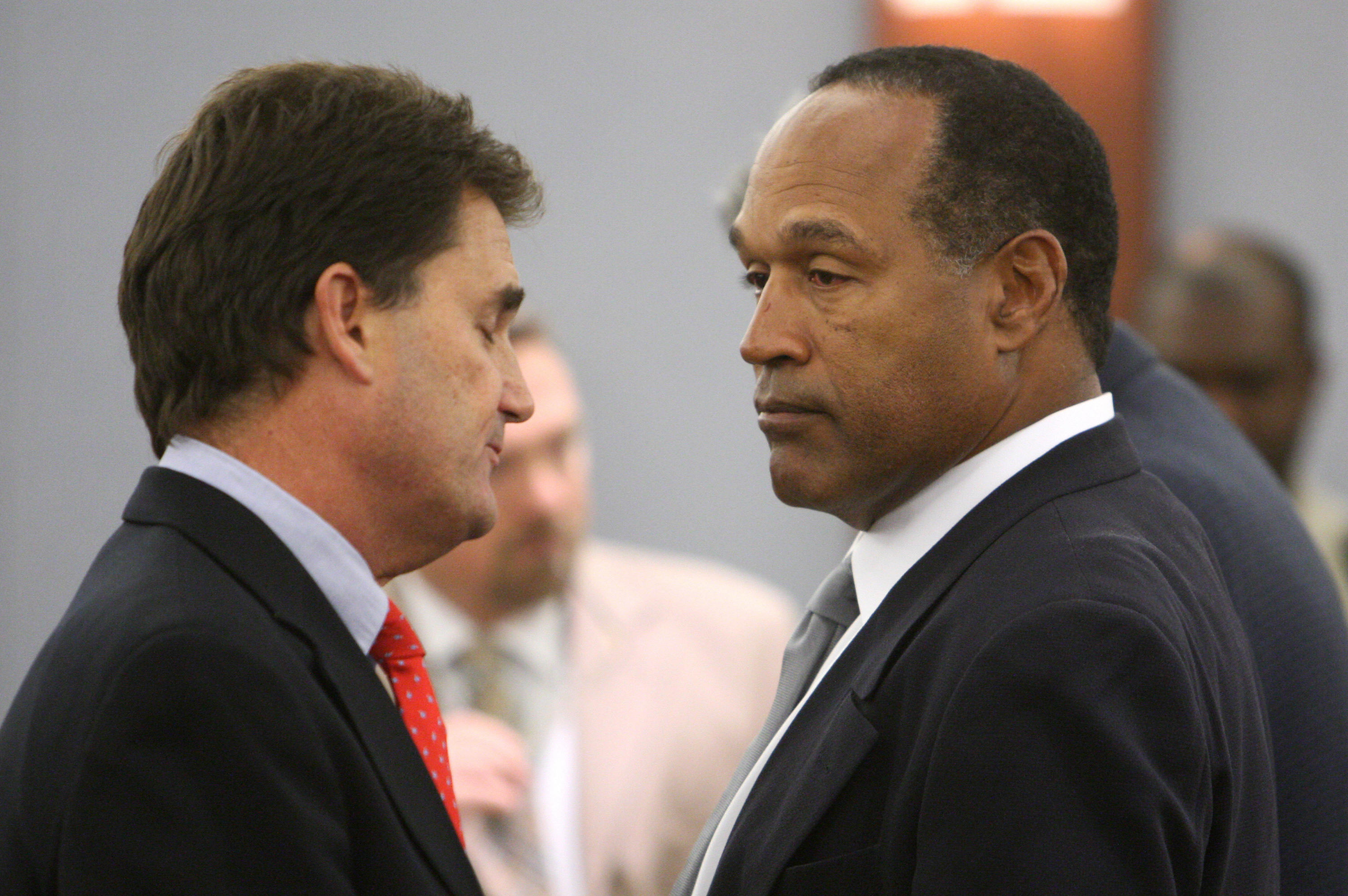 O.J. Simpson (R) and his Defense Attorne