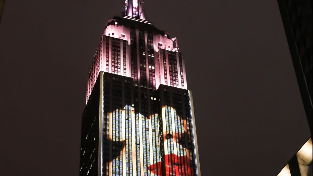 Harpers Bazaar celebrates its 150th anniversary with a light show of archival images projected on the Empire State Building
