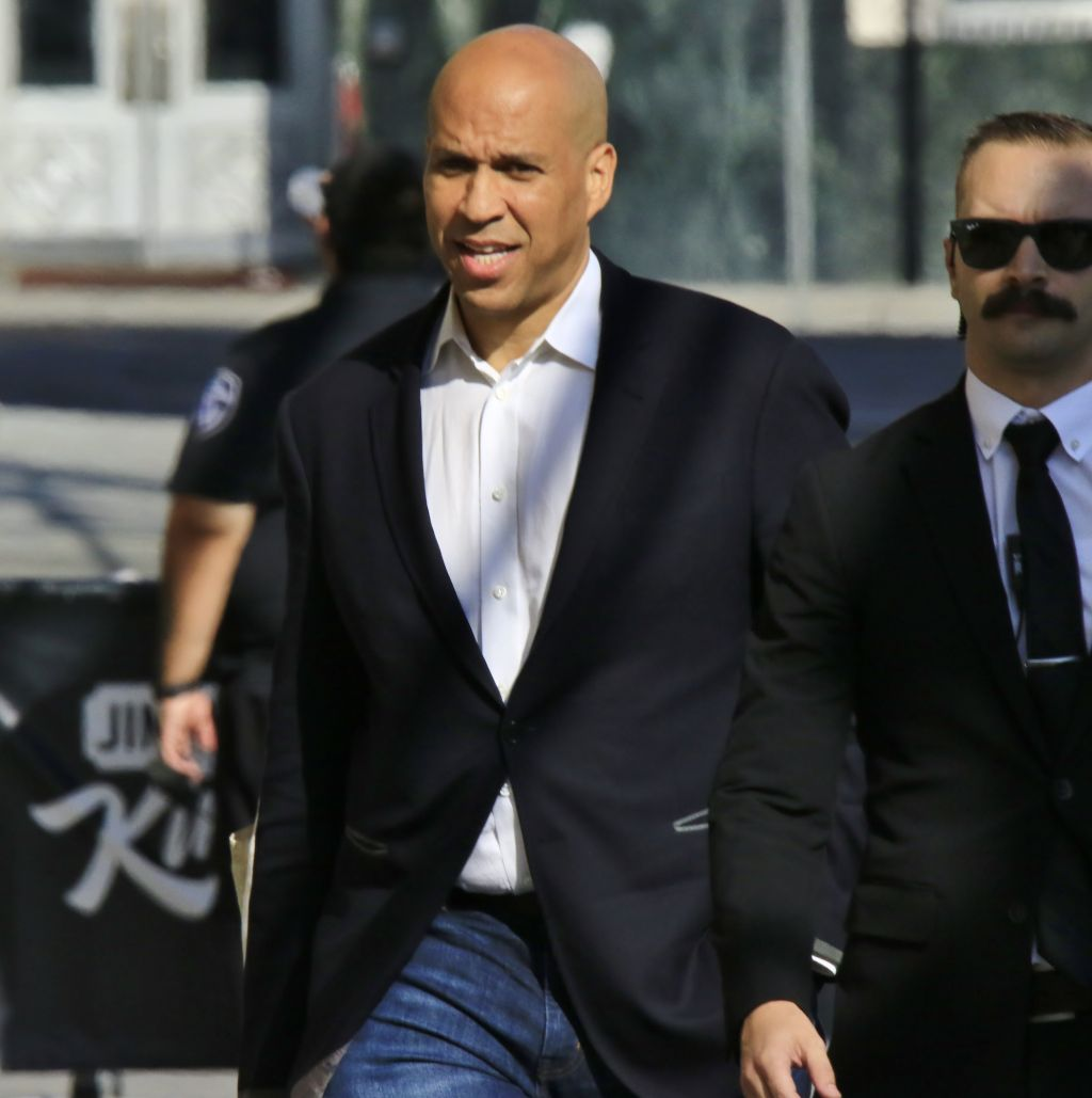 Senator Cory Booker is confronted by a metal detector as he arrives for an appearance on Jimmel Kimmel Live!