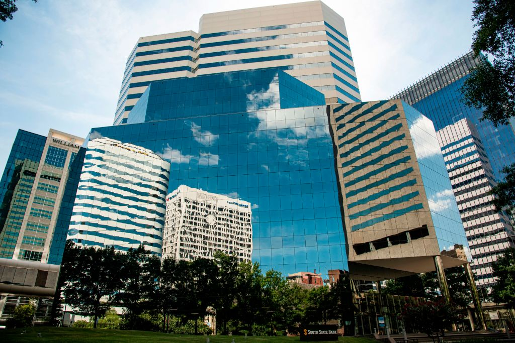 Skyline of Richmond, Virginia reflected on glass front wall of high rise building